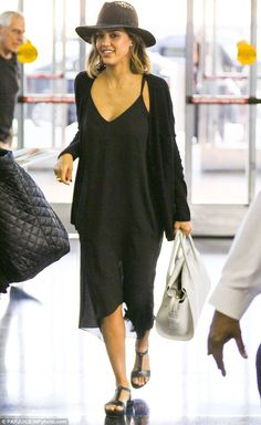 Looking good: A stylish Jessica Alba was spotted at the JFK airport in New York City on Fr...