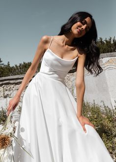 Meet Jenny Yoos Thalia gown for Fall 2020. Let out your inner socialite in the Thalia, who's soft Mikado and ballgown skirt were made forwaltzing around the dance floor. Featuring a scoop neckline, Open back long Chapel train skirt. This stunning & chic wedding dress is perfect for a Spring, Fall or Winter wedding!