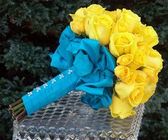 yellow roses & blue ribbon.. My exact colors I want :) a more aqua blue though