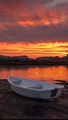 Boat at Cape Neddick, Maine. Red sky ocean sunrise. Source Flickr.com