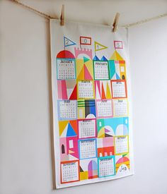 Love all the bright happy colors - very Mary Blair. A calendar could be a good way to commemorate the year of baby's birth?