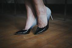 High-end, luxurious, sophisticated Carrano Brazilian shoes for the modern woman. These gorgeous pumps with a degrade-effect glossy black and light grey patent leather are perfect for a special occasion or just a casual day out.
