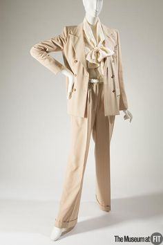 Pantsuit | Designer: Yves Saint Laurent (French, 1936-2008) | Beige wool twill with light and dark gray pinstripe | France, circa 1979 | The Museum at FIT