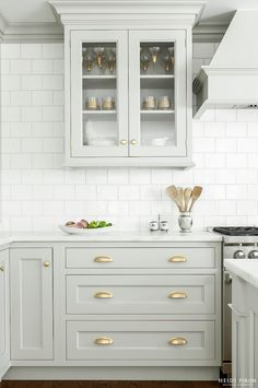 light gray cabinets with brass hardware