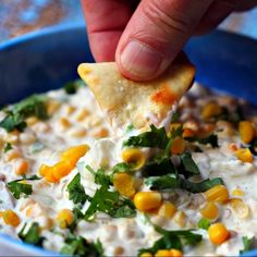 Addicting Zesty Corn Dip Recipe Appetizers with corn, light cream cheese, jalapeno chilies, cheddar cheese, cilantro, diced green chilies