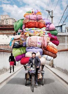 Vietnam is known for its cargo bikes, but these delivery men and women in China make the pedalers of Saigon look like pansies. Photographer Alain Delorme became fascinated with the bike haulers of China We Are The World, People Around The World, Wonders Of The World, Around The Worlds, Vietnam, Totems, Belle Photo, Shanghai, Bunt