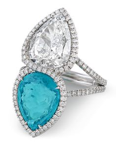 A spellbindingly beautiful 4.12-carat Paraiba tourmaline glows in this stunning ring A vibrant 2.93-carat diamond with D color and VS1 clarity is paired with this Paraiba