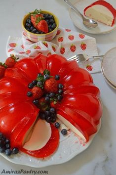 A luscious cream cheese sweet gelatin layer hugged by a strawberry jello and topped with fruits. A delicious no bake easy dessert that has the wow factor you need. Jello Cake, Jello Desserts, Jello Recipes, Easy Desserts, Dessert Recipes, Easy Recipes, Recipes Dinner, Healthy Recipes, Drink Recipes