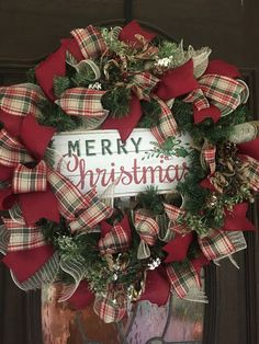 Beautiful plaid ribbon in traditional Christmas colors make this wreath festive and welcoming. It has accents of flocked pine cones and pine stems. A beautiful addition to any entryway during the holidays Merry Christmas, Burlap Christmas, Christmas Colors, Christmas Crafts, Christmas Ornaments, Christmas Quotes, Christmas Trees, Primitive Christmas, Country Christmas