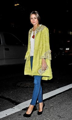 Olivia Palermo in an embellished yellow Marchesa coat, white brocade blouse, and statement necklace.