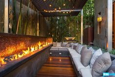 outdoor lounge with a fireplace.