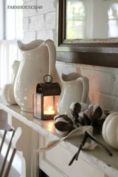 As an alternative to gold, you could use simple ivory pottery pieces to decorate the mantle-- so simple and so pretty!
