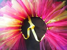 DIY Tutu made with ribbon.....ive made one, super easy to do.  OMG why didnt I think of this.  Such a good idea