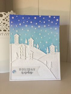 I love the glittery snowy hills!! I Ink blended with Blueprint Sketch and Tumbled Glass the background. Added texture paste through the snowfall stencil and sprinkled glitter on before it dried. When it was dried I sprayed a bit of Perfect Pearls spray on the background. I die cut Poppy Stamps Brevilla Hillside 3 times and layered it for dimension. Added crystal ultrafilne glitter to the other pieces cut from the die.