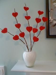 Stick paper or felt hearts on to bare branches and stick it in a vase. Simple and beautiful #valentinesday #decor #DIY