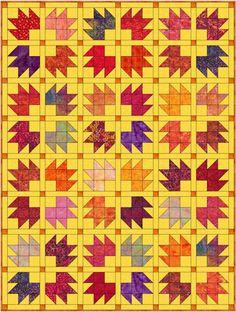 Bear Tracks quilt blocks set with sashing and contrasting cornerstones
