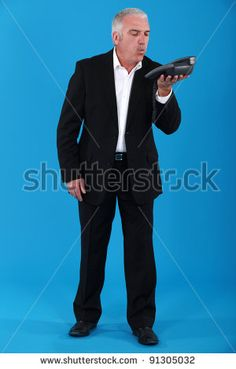 Man Blowing Into Phone Stock Photos, Images, & Pictures | Shutterstock
