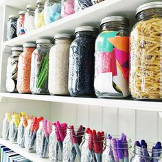 Mason jars of all shapes and sizes are great for storing creative materials in the classroom.