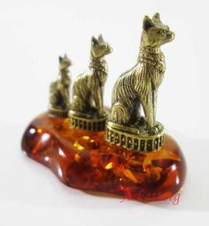 "Bronze Brass Figurine Statuette Russian "" Egyptian cat "" Baltic Amber # 75 Material - Solid Brass and Pressed Amber. Size statues together with amber:  4х2х3cm (1.57х0.79х1.18 inch) Weight 16g. Very high-quality study of fine details"