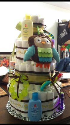 Standard unisex diaper cake with toys/accessories.