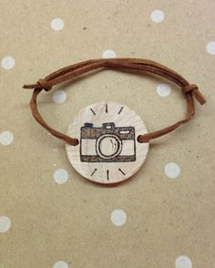 Wood burned camera bracelet on Etsy, $14.00