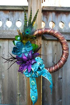 Teal and purple peacock christmas wreath by UrbanTwigs on Etsy Peacock Wreath, Peacock Decor, Peacock Theme, Peacock Wedding, Peacock Christmas Decorations, Christmas Mesh Wreaths, Deco Mesh Wreaths, Christmas Arts And Crafts, Christmas Diy