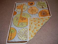 Hand stitched, Jungle Animals baby quilt by Ginnie's Threads (on Facebook) $50.