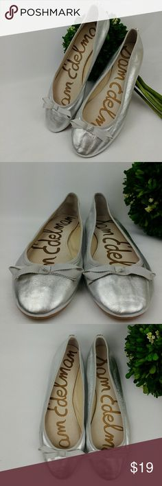 """Sam Edelman metallic silver ballet flats with bow Sam edelman milly metallic bow ballet flat. Leather upper Leather sock Size 10M 27 cm 3.25"""" at it widest Have lots of life left.  The metalic paint is kind of coming off. And the glue got darked you can see in pictures. Selling cheap and as is. They still look good overall. Sam Edelman Shoes Flats & Loafers"""