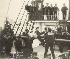 Horse play on a yacht.  Grand Duchesses Anastasia and Olga stand watching from the staircase, Tsar Nicholas II looks on from the ropes and Tsarevich Alexei is in the bottom lefthand corner.