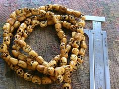 108 bone skull bead mala 7x10mm beads Day of the Dead. $13.50, via Etsy.