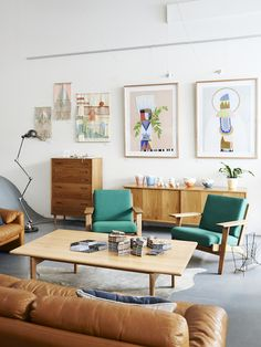 Mid Century living room idea with brown sofa and over-sized wall art