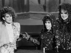 Prince accepting his 1985 Oscar for Best Original Score, with Wendy and Lisa.
