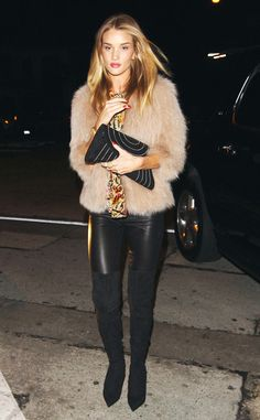 Rosie Huntington-Whiteley from Celebs in Coats  Rosie stuns in a cozy fur coat and over-the-knee black boots.