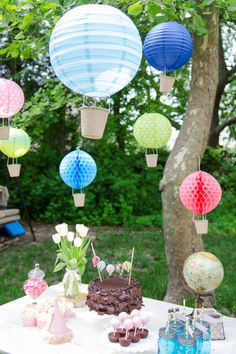 Hot air balloons made from paper lanterns. Such a neat idea! Love this whole party.
