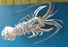 Caribbean spiny lobster sculpture... Best seller lots of detail.. Hand drawn and plasma cut aluminum.... Www.metalgamefish.com