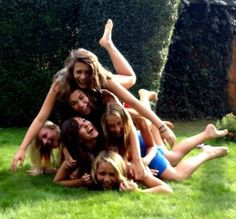 Marlene McKinnon, Dorcas Meadowes, Lily Evans, Mary Macdonald, Amelia Bones, and Hestia Jones trying to make a pyramid when James and Sirius said they couldn't do it. Spring of 1975.