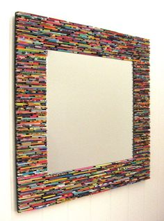 colorful square mirror wall art- made from recycled magazines blue green red purple pink yellow orange Mirror Wall Art, Diy Mirror, Beaded Mirror, Mirror House, Sunburst Mirror, Recycled Magazines, Recycled Crafts, Recycled Materials, Art Diy