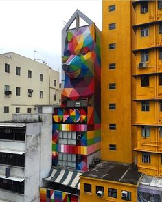 Colorful, geometric, prismatic, happy: words we would use to describe @okudart's #streetart. How would you describe it?