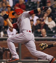 Cincinnati Reds' Zack Cozart hits a two RBI single to put the Reds ahead of the San Francisco Giants during the eleventh inning of a baseball game, Saturday, June 28, 2014, in San Francisco. (AP Photo/George Nikitin)