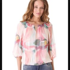 Shop Women's Alice & Olivia Pink Blue size XS Blouses at a discounted price at Poshmark. Description: This gorgeous silk blouse is a watercolor print of soft pastels. There is a keyhole front and back and the neckline is stretchy enough that I think it could even be worn off the shoulders. Center is lined and the sleeves are sheer. No stains or snags. The only thing that shows it may have been worn is a small A written on the tag! New, this top retails for $295!. Sold by sharonmarie84...