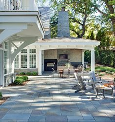 Bluestones patio flooring - Shingle-Style residence on Lake Minnetonka, designed by Swan Architecture
