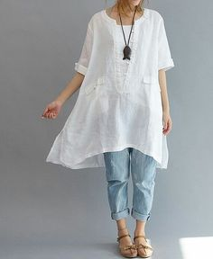 This outfit reminds me of a true Summer day. Comfortable and styled. Easy, effortless. Cuffed sleeves, asymmetric hem, cuffed denim and a pair of espadrilles. LOVE.