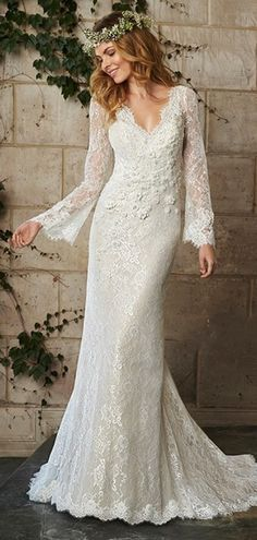 Long wedding dress with long sleeves, perfect for a boho chic wedding. www.bestweddingshowcase.com