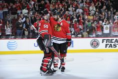 Crawford and Seabrook celebrate the 4-1 win over the Nashville Predators on Dec. 8! #Blackhawks