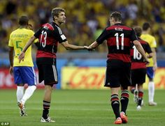 Deadly duo: Muller and Klose congratulate each other as Germany continued to score. July 8/14
