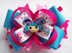 This Little LaLa Girls Bow. The hair bow measures about 5 inches across and is made on a partially lined hair clip. This bow is so cute. The bow looks great worn alone but would also look great attached to a headband or hat for an infant, baby or toddler.  $8.00