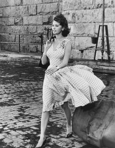 Sophia Loren. Would love to see this type of dress make a come back.