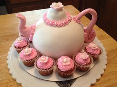 Tea anyone?  I made this cake for a friend's 4 year old daughter's tea party birthday celebration.  It was a hit!  Thanks Brandi!  Strawberry cake w/Buttercream filling/frosting, covered with MMF. Wilton flowers, gum paste spout and handle