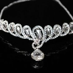 Topwedding Silver Plated Bridal Helical Rhinestone Crystal Pendant Prom Crown Hair Tiara Necklace Adjustable Chain Topwedding. $16.59. Made with high quality clear Austrian crystals in silver plated metal setting. The width of beautiful diamond about 1inches/2.5cm. Circular length measure of 9inches/24cm£¬head diameter of 6inches/14cm. These jeweled tiaras are the perfect accessories for Weddings, Proms, Pageants, Parties Birthday, or other special occasions.. Feat...