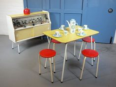 1950s Formica cabinet, dining table and stacking stools on eBay